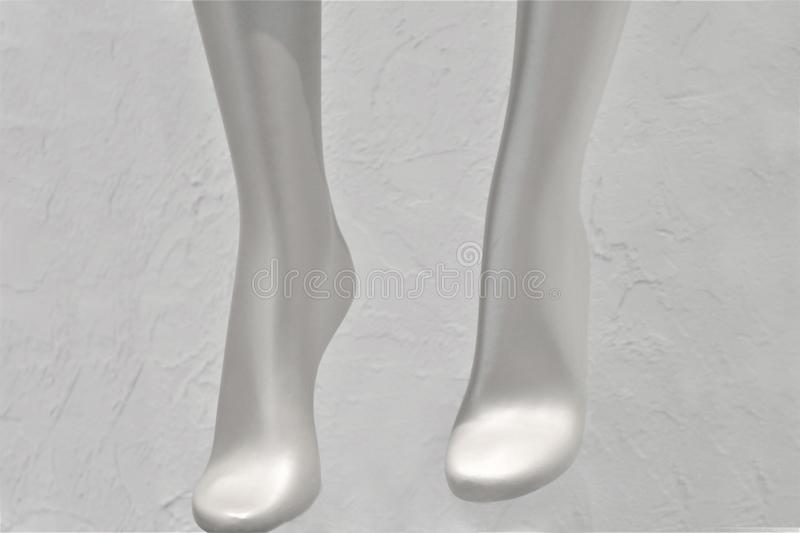 Silver mannequin legs stock image