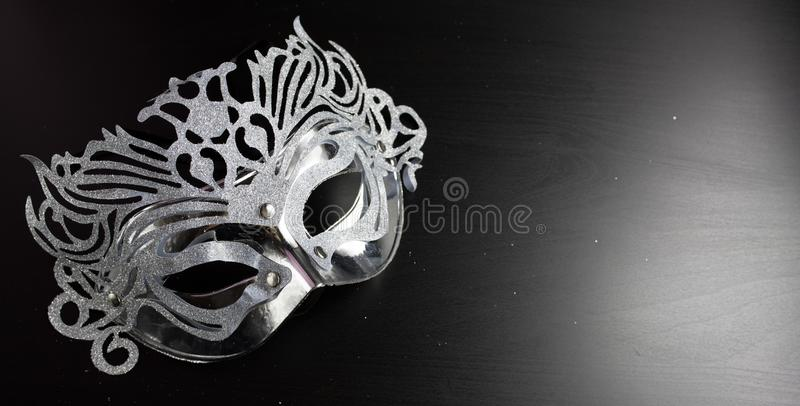 Silver mardi gras mask , Placed on a Black background. royalty free stock photos