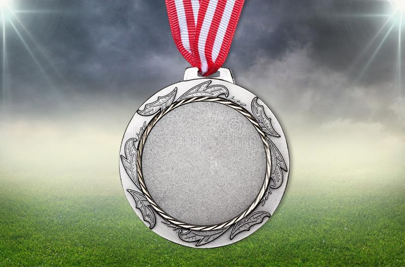 Silver medal on stadium background stock photos