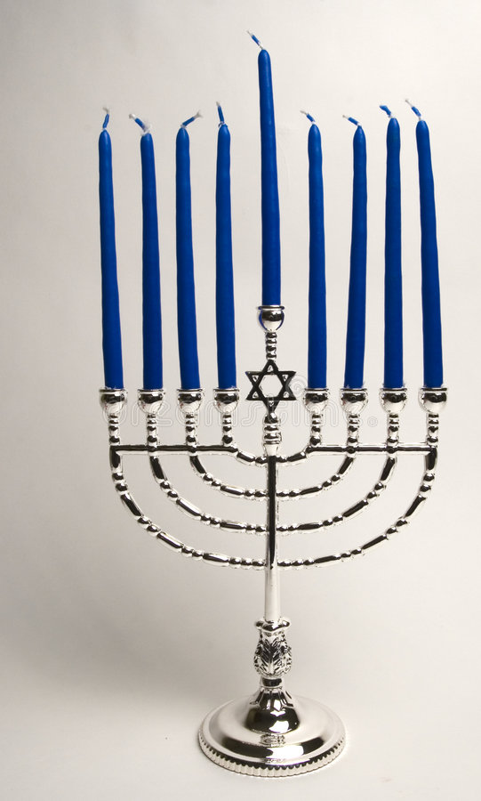 Silver Menorah with candles royalty free stock image