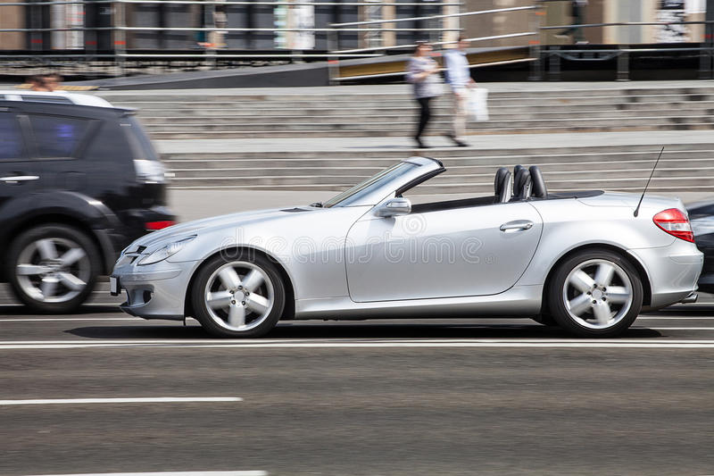 Silver Mercedes Benz convertible in town. Car in motion royalty free stock images