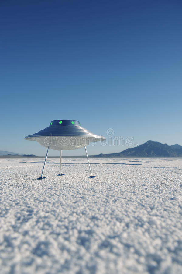 Silver Metal Flying Saucer UFO Harsh White Desert Planet Landscape. Silver metal flying saucer UFO landed on harsh white desert planet landscape royalty free stock images