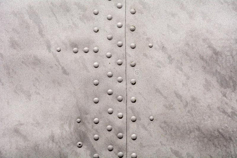 Metal texture with rivets stock image