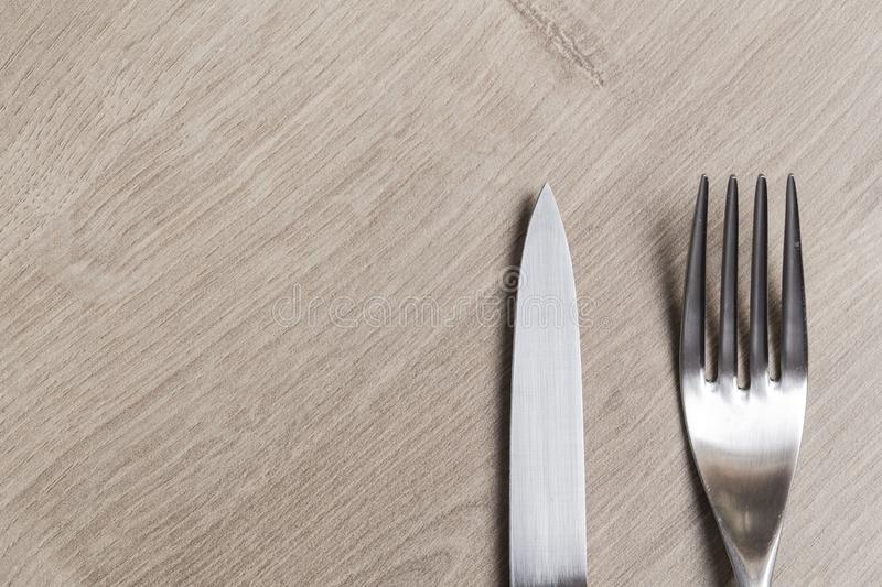 Silver modern knife and fork royalty free stock photo