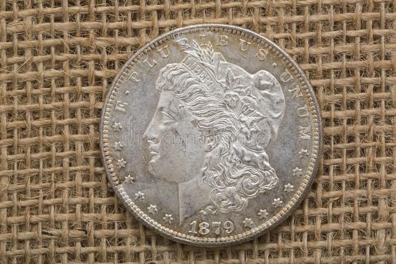 Silver Morgan dollar 1879 obverse front. The United States Morgan silver dollar coin is a symbol of American financial strength and has not been minted for many stock images