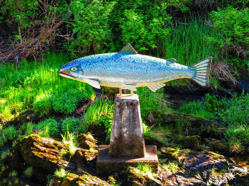 Silver mosiac salmon statue in Ketchikan royalty free stock photography