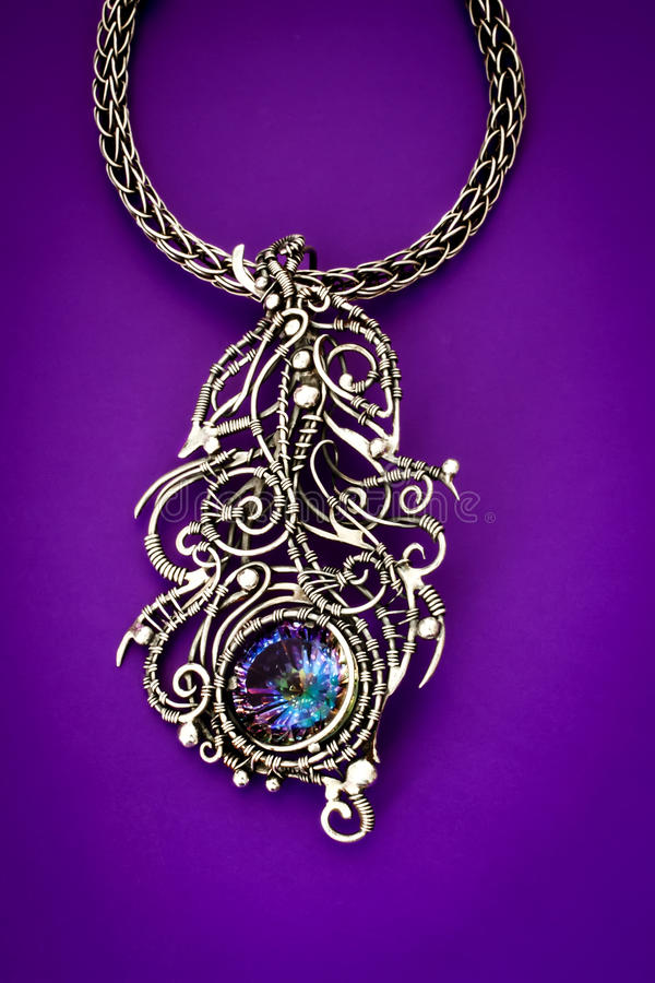Silver mystic topaz feather pendant stock images