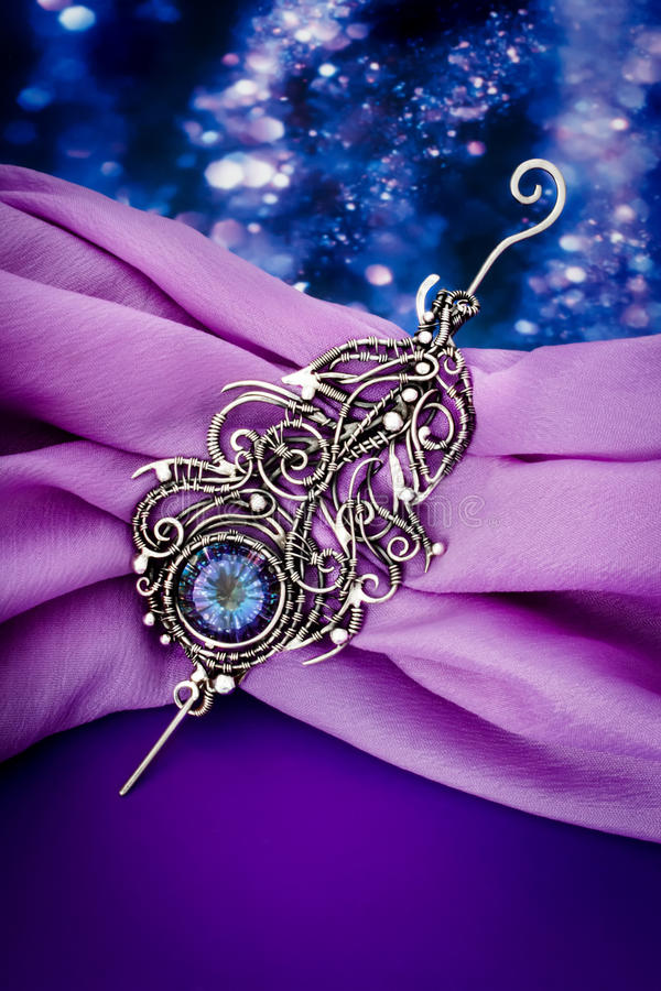 Silver mystic topaz feather pendant brooch royalty free stock photo