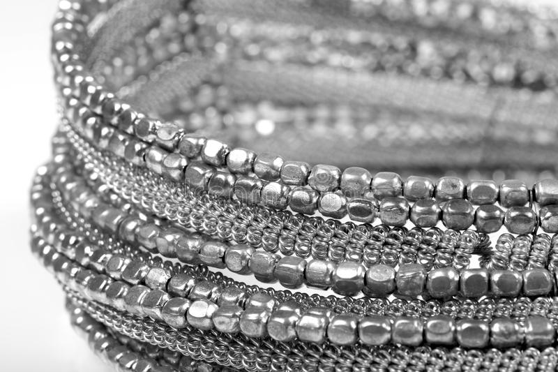 Silver necklace. Beautiful shot of silver necklace on white background stock images