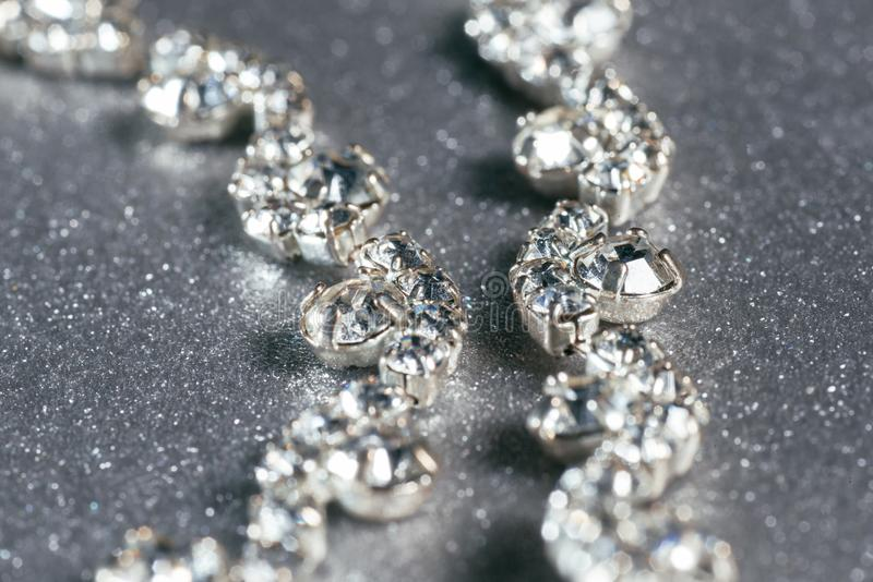 Silver necklace with diamonds close-up on a grey background stock photo