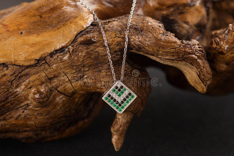 Silver necklace with emerald stock photography