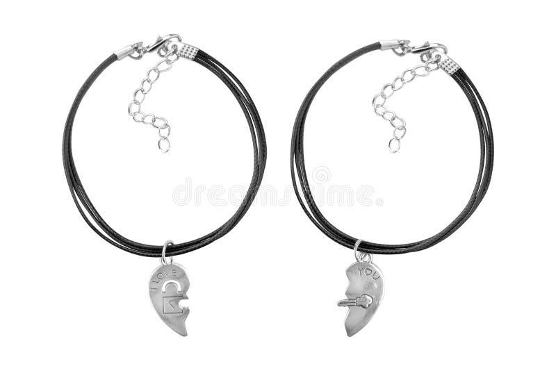 Silver och den svarta textilen som det justerbara armbandet med I älskar dig hängen som isoleras på vit bakgrund, urklippbanan, i royaltyfria foton