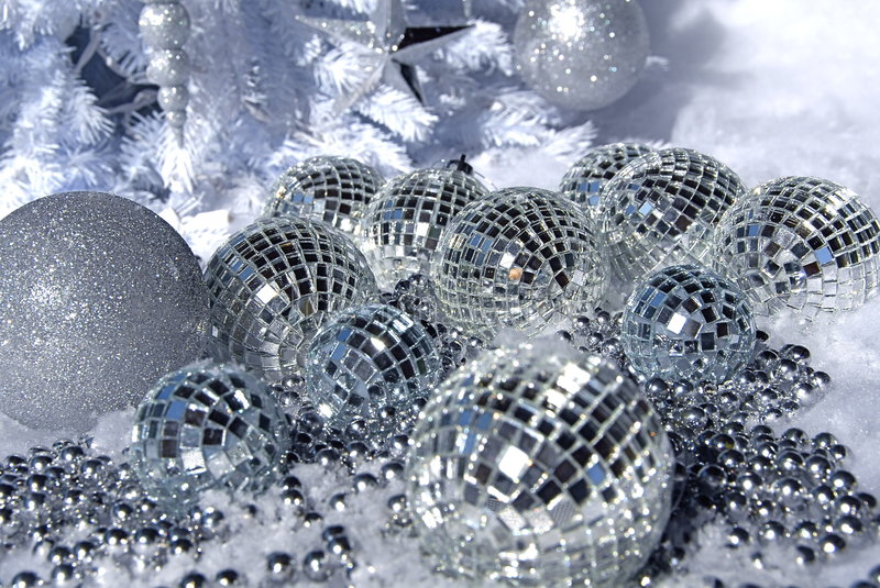 Silver ornaments. On a white blanket of snow royalty free stock photography