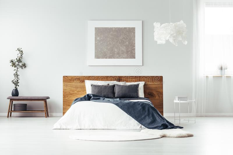 Silver painting in spacious bedroom royalty free stock photo
