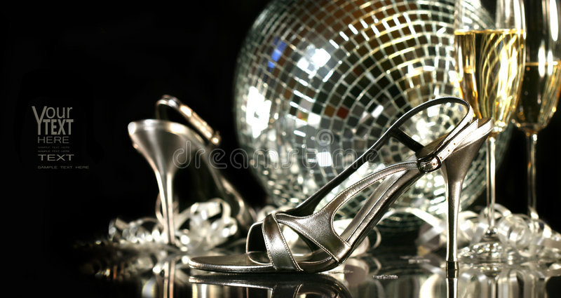 Silver party shoes with champagne glasses royalty free stock photo