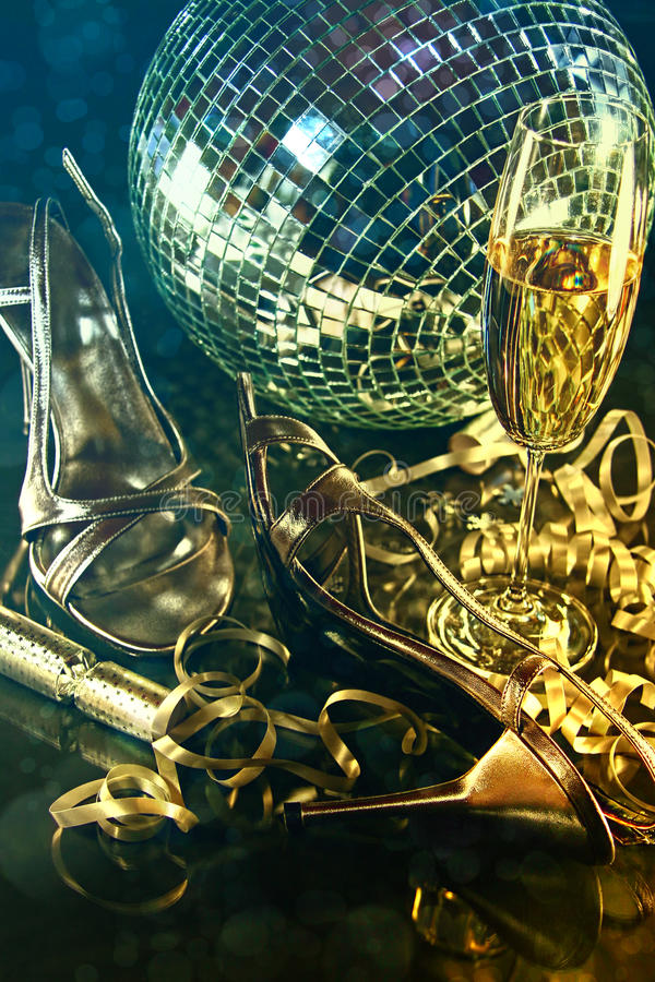 Silver party shoes on floor with champagne glass. For New Year's Eve royalty free stock photography
