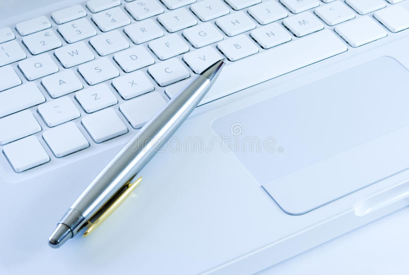 Download Silver Pen On A Laptop Keyboard Stock Photo - Image: 10667082