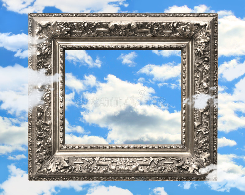 Silver picture frame against a blue sky royalty free stock images