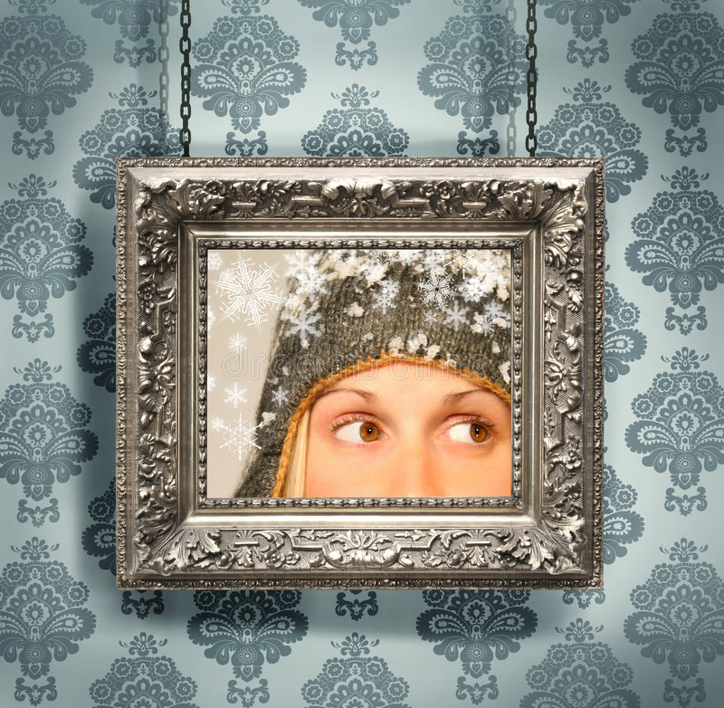 Silver picture frame against floral wallpaper. Silver picture frame hung against floral wallpaper background/ blue stock images