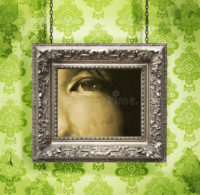 Silver picture frame hung against floral wallpaper royalty free stock photos