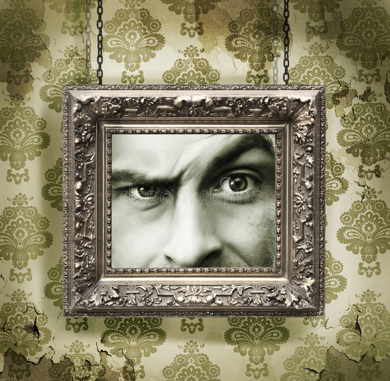 Silver picture frame on wallpaper. Silver picture frame hung against floral wallpaper background stock photos