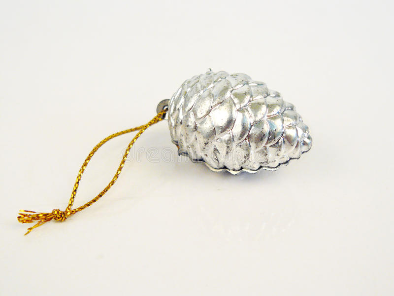 Silver Pine Cone. Toy on white background. Festive decoration design for celebration on christmas, new year, valentine and birthday party stock photo