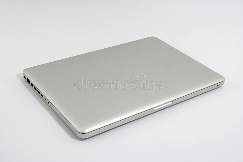 Silver portable computer. Isolated on grey background royalty free stock photo