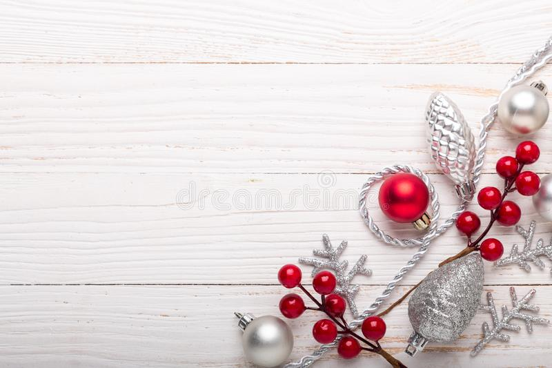 Silver red christmas gifts on white wooden background royalty free stock photography