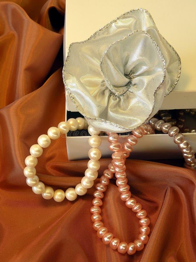 Silver ribbon and pearls royalty free stock photo