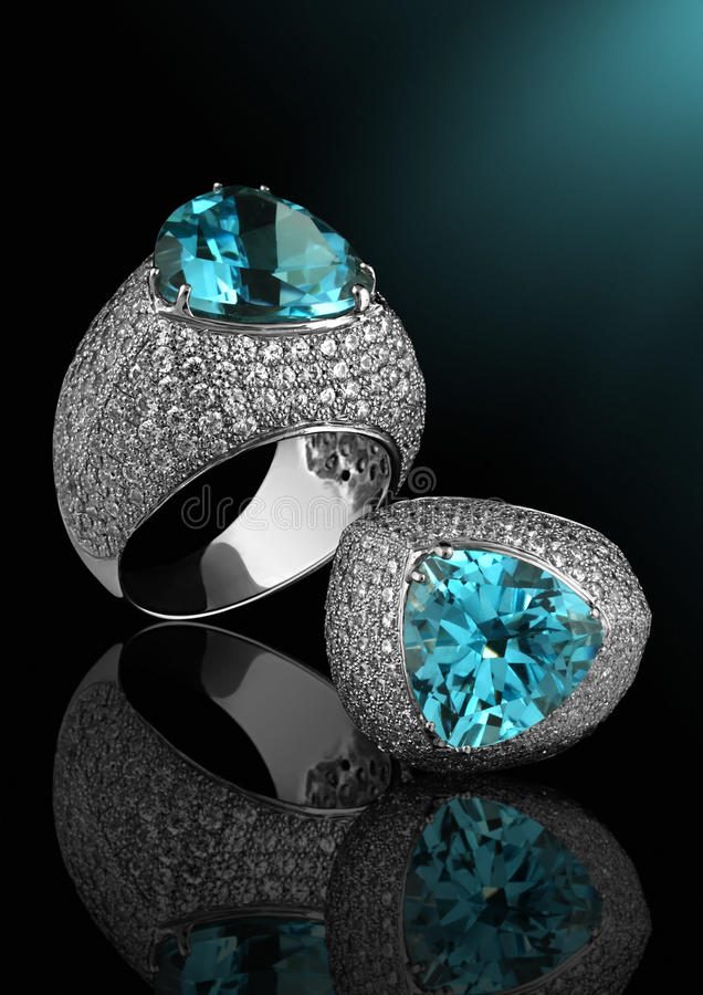 Silver ring with diamonds and topaz royalty free stock photography