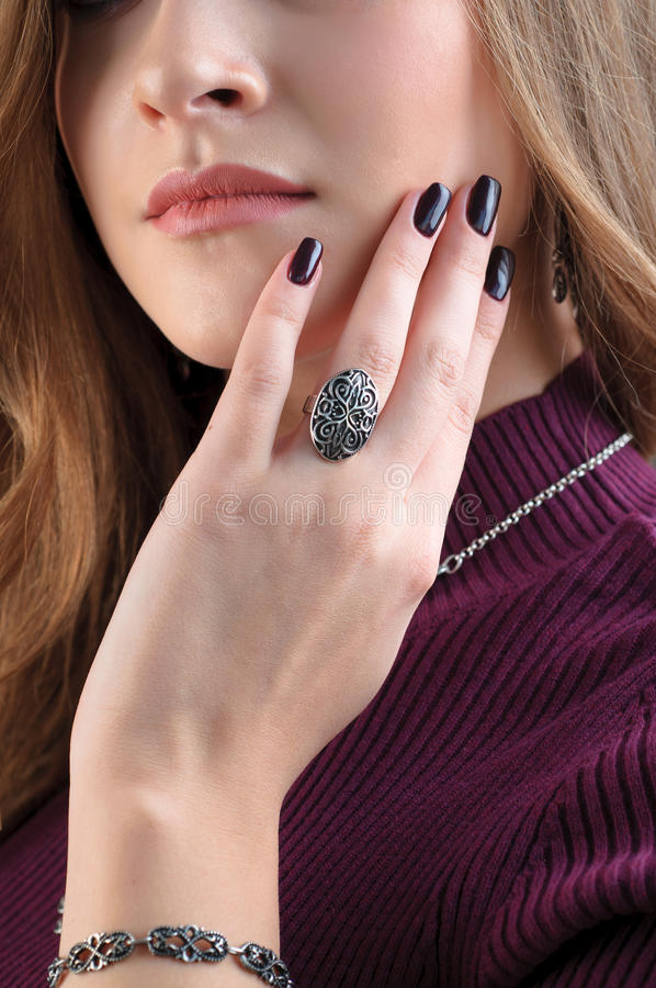 Silver ring on finger. Close up female model wearing ethnic jewelry. The silver ring on finger. Close up female model wearing ethnic jewelry stock photos