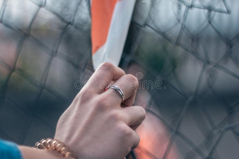Silver ring on girl`s hand royalty free stock photos