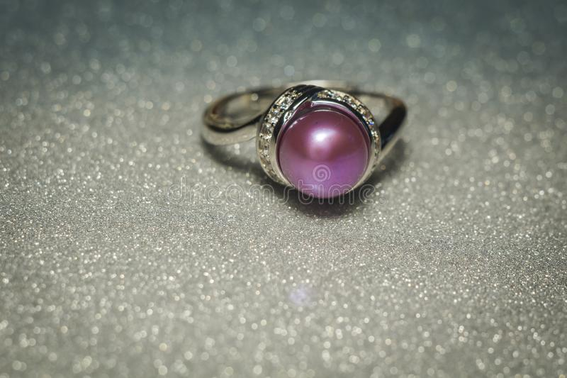 Silver ring with purple pearl royalty free stock photography