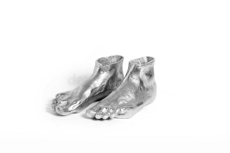Silver sculpture vase of human foot form. On white background royalty free stock image