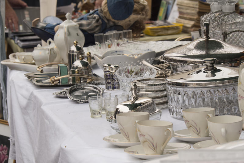 Silver seen on flea market. Italian flea market presents silver and tableware stock image