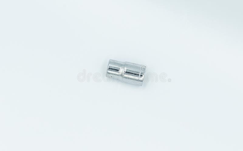 Silver socket wrench in a white studio stock image