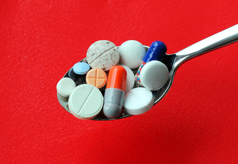 Silver Spoon With Pills Royalty Free Stock Images