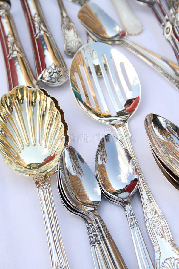 Silver spoons. A selection of spoons on a market stall stock photos