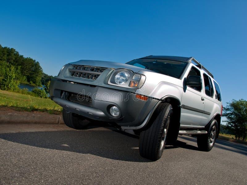 Silver Sports Utility Vehicle low pavement angle