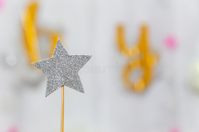Silver star decoration made with glitter over gray background. Christmas simple composition minimal concept with copy space.  royalty free stock image