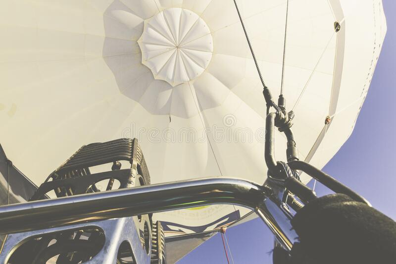 Silver Steel Bar Near Steel Blow Torch on White Hot Air Balloon during Daytime stock photos