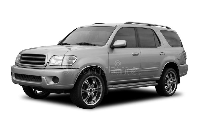 Silver SUV. With decorative wheels, isolated on a white background royalty free stock photo