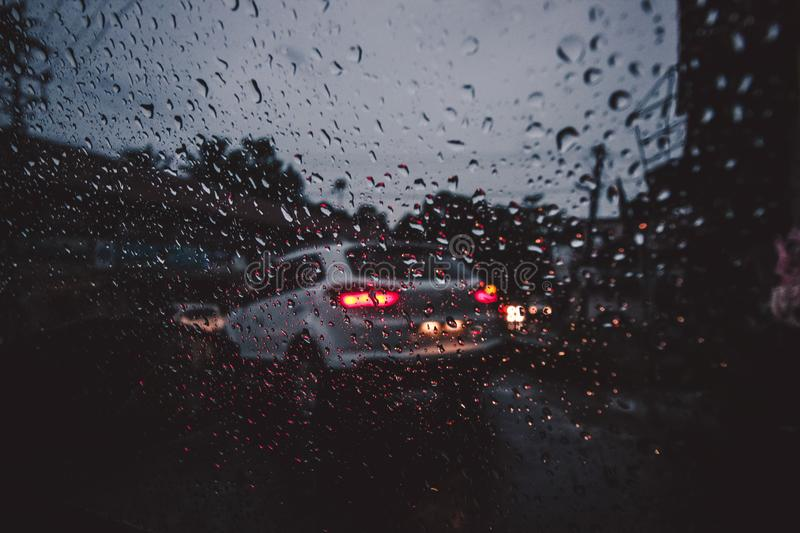 Silver Suv on Asphalt Road during Rain stock image
