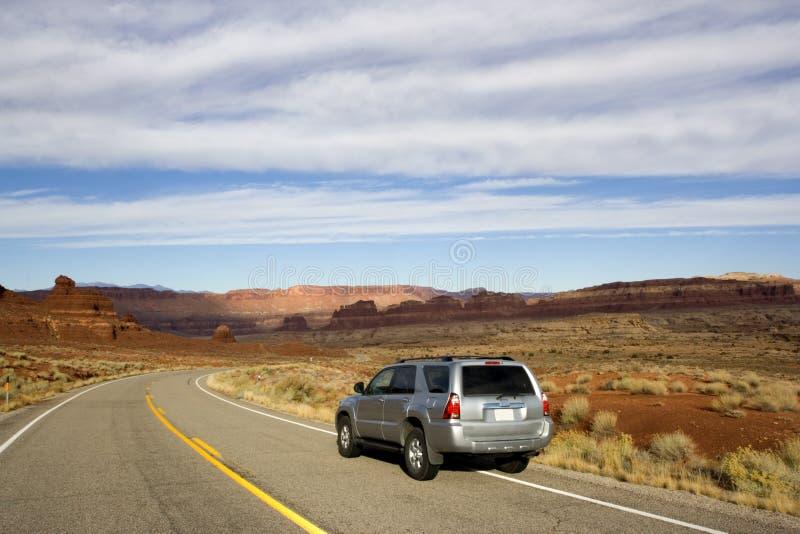 Silver SUV driving in Utah. stock photo