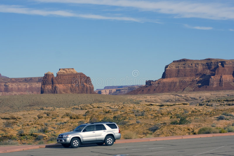 Silver SUV driving in Utah. stock photos