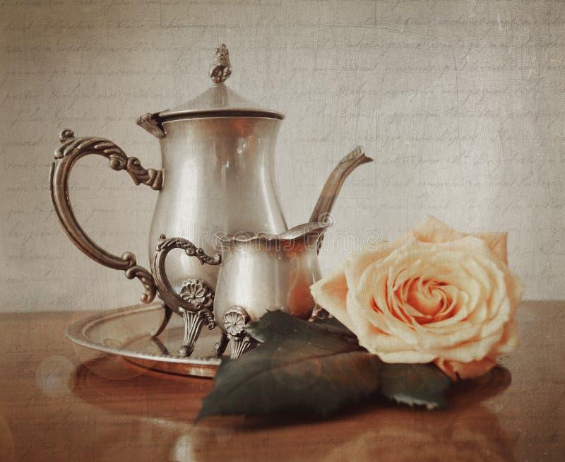 Silver tea set with retro vintage Instagram style effect. Silver tea set with retro vintage Instagram style filter effect stock photos