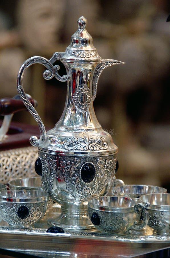 Silver tea set on a silver platter. Tunisisan silver tea set on a silver platter with blur background stock photos
