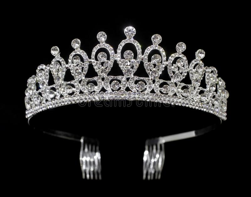 Silver tiara diadem with gems and diamonds isolated on black background stock image