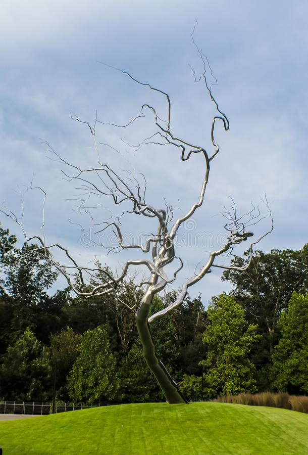 Silver tree structure on grounds of Crystal Bridges Museum of American Art - Bentonville Arkansas USA 8-24-2017. Silver tree structure on green grounds of royalty free stock images