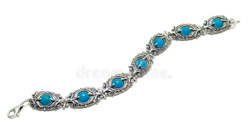 Silver turquoise bracelet. Isolated on white stock photography